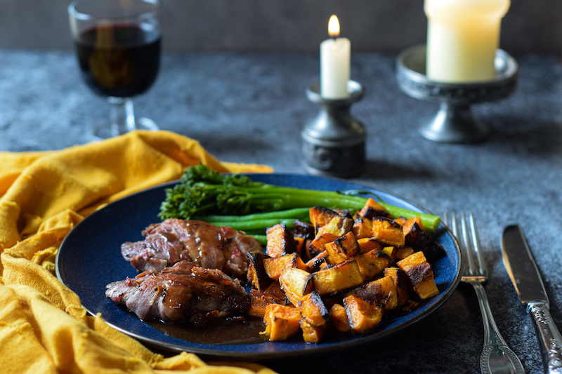 Pan-fried grouse with roasted sweet potatoes, pancetta and sticky sherry-soy sauce
